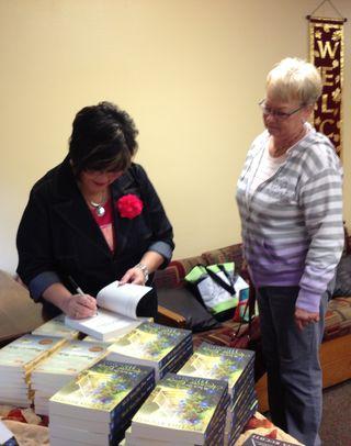 Cynthia signing at Camp Lebanon 1 2013